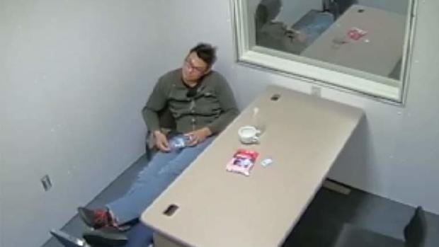 Dinh Bowman waits to be questioned by police