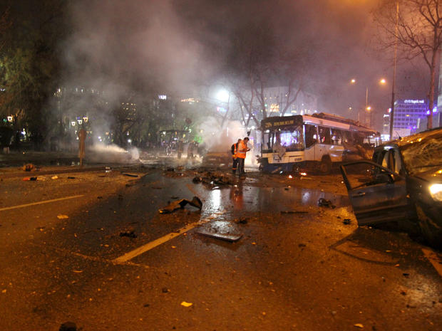 Emergency workers work at the scene of a massive explosion in Ankara