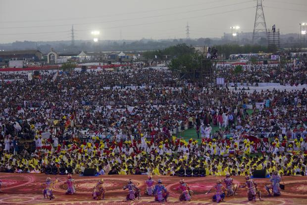 "Thousands of followers of Indian guru Sri Sri Ravishankar gather for a performance at a three-day festival in New Delhi, India, organized by the guru's ""Art of Life"" foundation"
