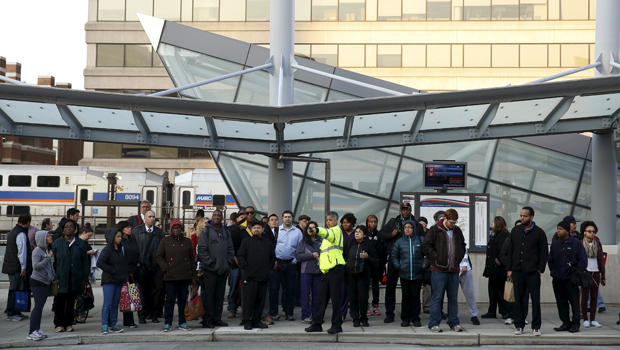 Morning commuters await a bus for downtown Washington in Silver Spring, Maryland, March 16, 2016.