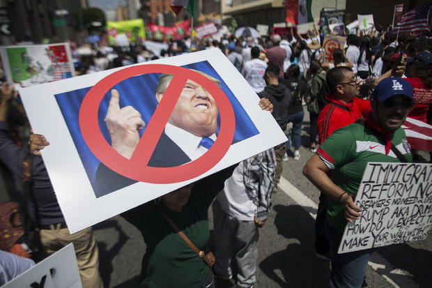 Woman carries placard critical of Donald Trump during May Day march in Los Angeles onMay 1, 2016