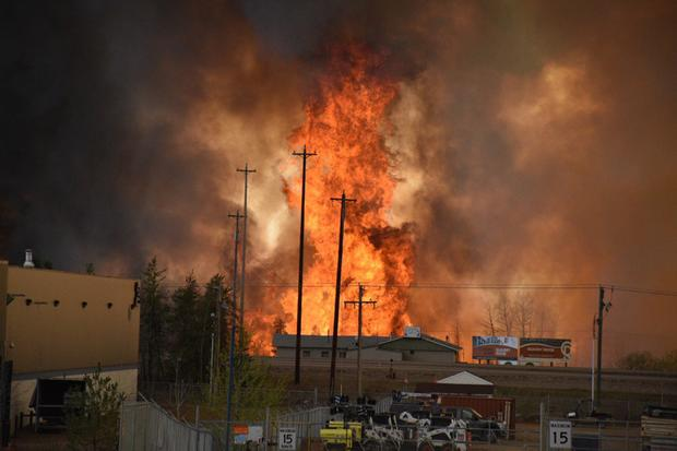 Flames rise in an industrial area south Fort McMurray, Alberta, Canada, on May 3, 2016.