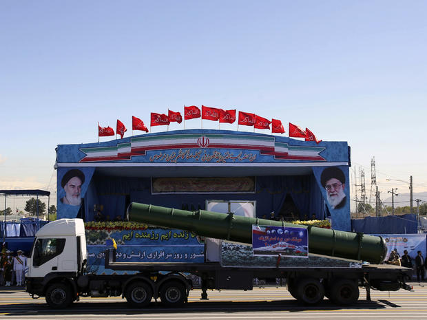 An Iranian military truck carries parts of the S200 missile system during an Army Day parade in Tehran