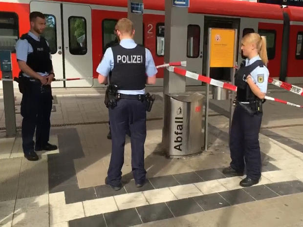 German police at the scene of a stabbing attack at the Grafing train station, near Munich in southern Germany