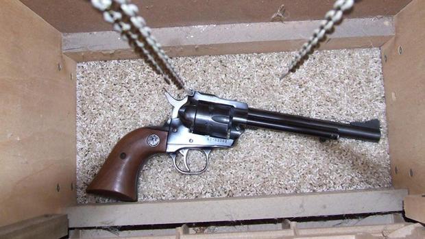 Gun inside grandfather clock