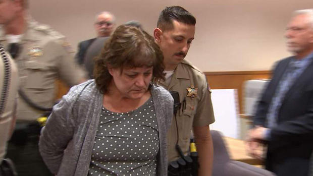 Jane Laut is escorted from the courtroom after the verdict