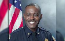 Ferguson swears in city's first African-American police chief