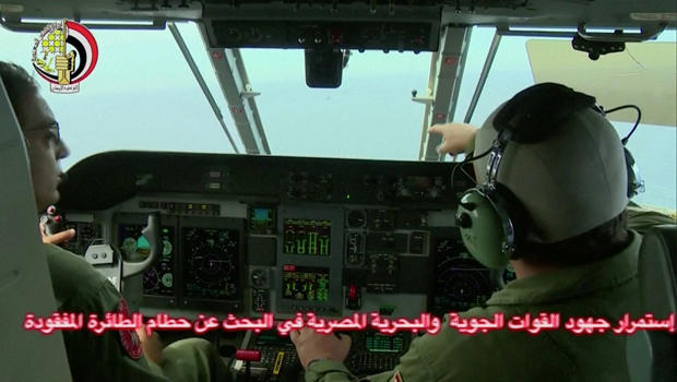 ​An Egyptian pilot points during a search operation by Egyptian air and navy forces for the EgyptAir plane that disappeared in the Mediterranean Sea in this still image taken from video May 20, 2016.