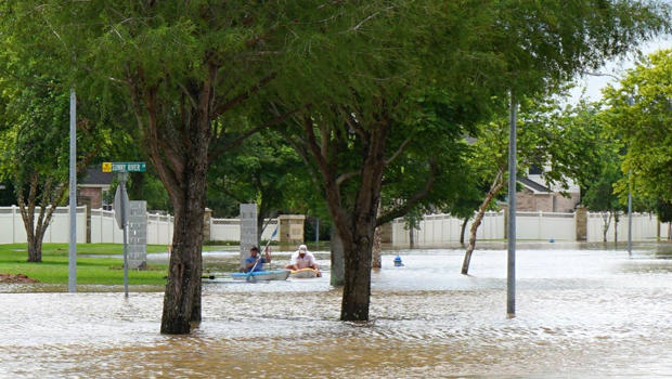 People use kayaks in floodwaters in Fort Bend County after heavy rainfall caused the Brazos River to surge to its highest level causing flooding outside Houston, Texas, in this picture taken June 1, 2016, courtesy of the Fort Bend County Sheriff's Office.