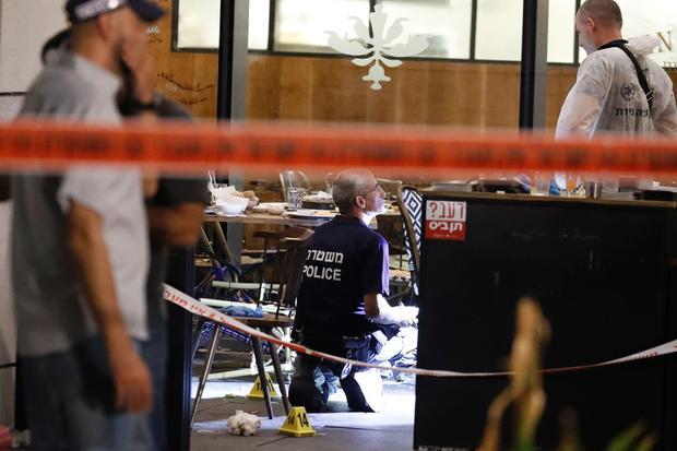 Israeli forensic police inspect restaurant following terror attack in Tel Aviv market on June 8, 2016