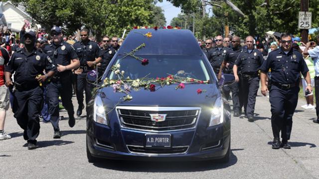 Louisville Metro Police surround Muhammad Ali's hearse as it drives past his boyhood home in Louisville, Kentucky, June 10, 2016.
