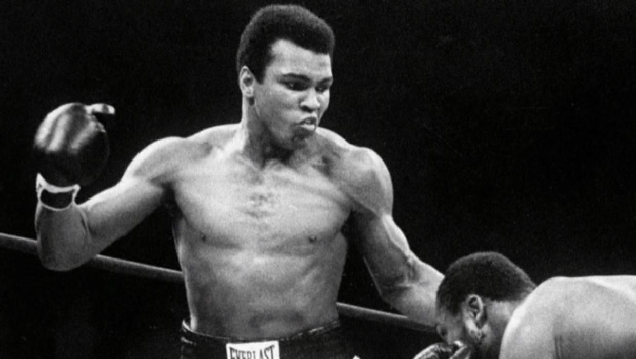 a research on the newspaper coverage of muhammad alis winning the heavyweight boxing championship Muhammad ali's most famous opponent, and a boxing legend of his own making, died of liver cancer at age 67 a look back at the fighter's life in pictures.