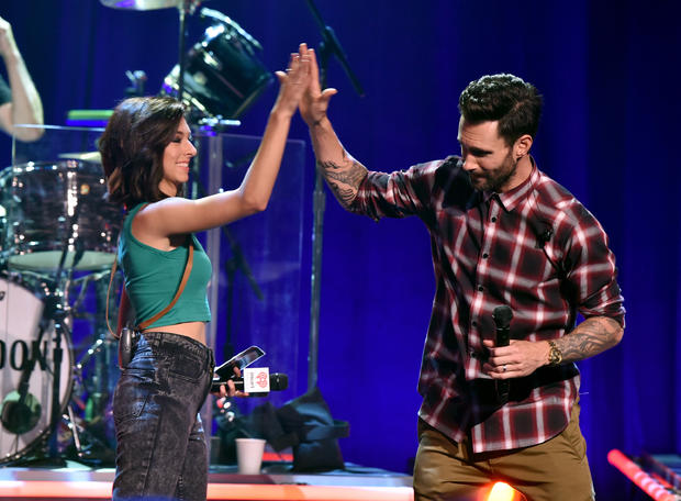 Singers Christina Grimmie and Adam Levine speak onstage during the iHeartRadio Album Release Party with Maroon 5 on the CW at iHeartRadio Theater on Aug. 26, 2014, in Burbank, California.