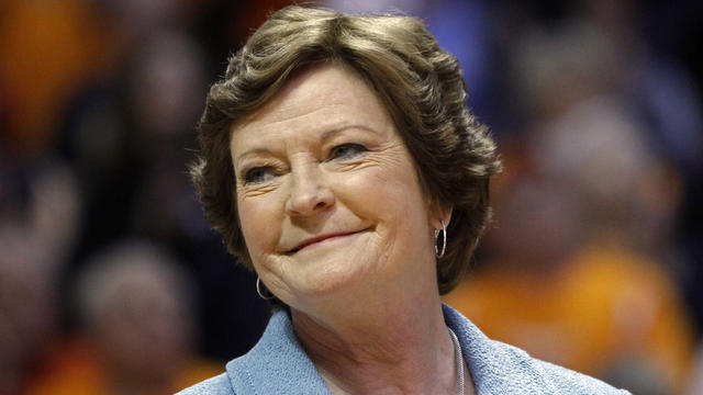 January 2013 file photo shows former Tennessee women's basketball coach Pat Summitt smiling as banner is raised in her honor before team's game against Notre Dame in Knoxville, Tennessee