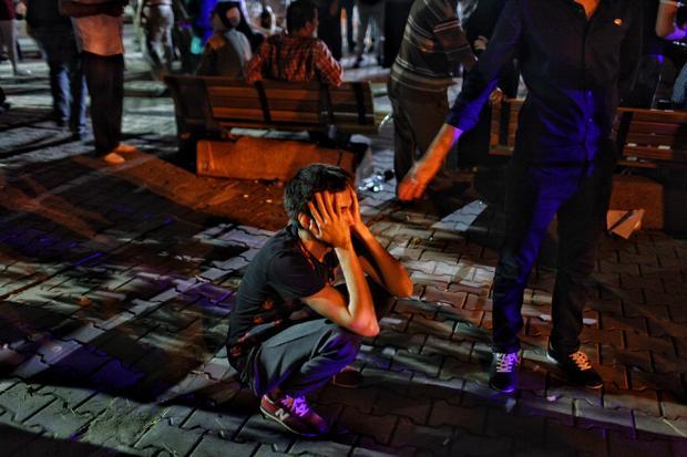 Relative of victim of June 28, 2016 attack in Ataturk Airport waits outside Bakirkoy Sadi Konuk Hospital in early hours of June 29, 2016 in Istanbul, Turkey