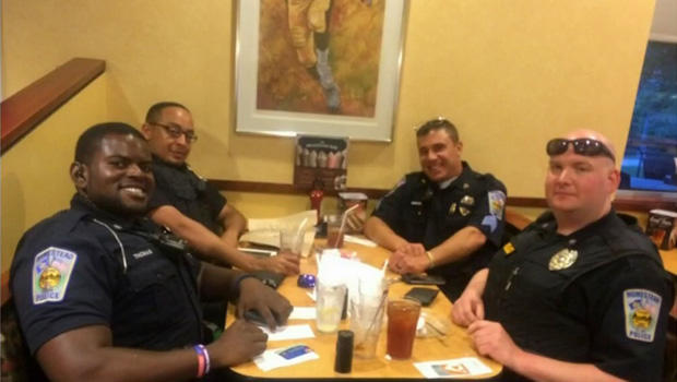 ​A group of police officers dine at an Eat'n Park restaurant in Homestead, Pennsylvania, in this picture provided to CBS Pittsburgh station KDKA-TV.