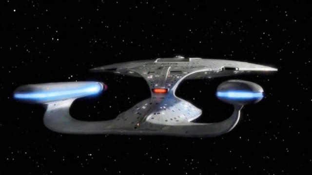 Image of star trek next generation enterprise flying in space