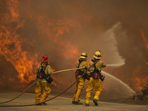 Wildfire explodes outside Los Angeles