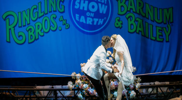 High wire walkers Mustafa Danguir and Anna Lebedeva of Ringling Bros. and Barnum & Bailey exchange wedding vows 30 feet above the NRG Stadium floor on a high wire that is no wider than a human thumb at NRG Park on July 26, 2016, in Houston, Texas.