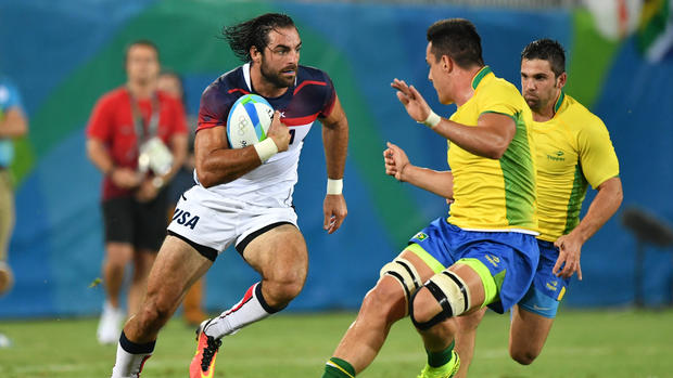 USA's Nate Ebner runs with the ball in the men's rugby sevens match between USA and Brazil during the Rio 2016 Olympic Games at Deodoro Stadium in Rio de Janeiro on Aug. 9, 2016.