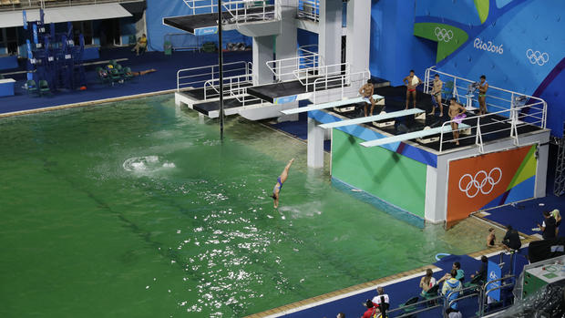 This is why the Olympics pools turned green - CBS News
