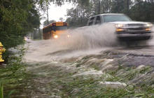 Heat waves and flooding grip U.S.
