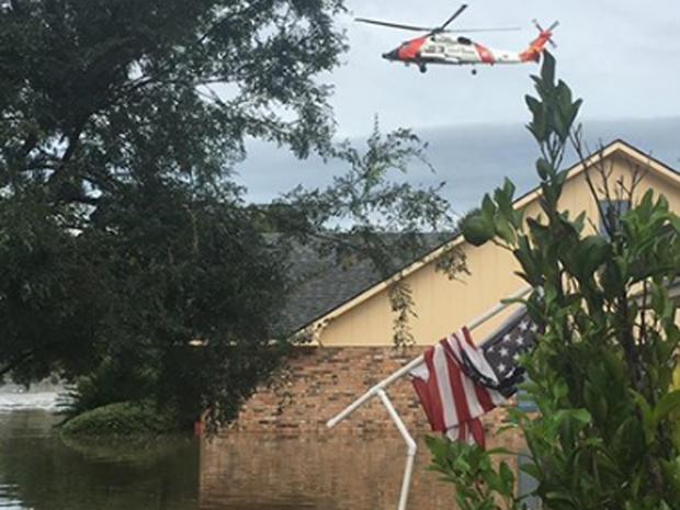 Coast Guard chopper flies over flooding in Baton Rouge, Louisiana on August 14, 2106