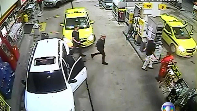 Security video shows three U.S. Olympic swimmers returning to their taxi at a gasoline station where they were accused by staff of having caused damage in Rio de Janeiro, Brazil, Aug. 14, 2016.