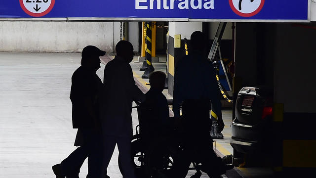 International Olympic Committee member Patrick Hickey leaves in a wheelchair from Samaritano Barra Hospital after being arrested on allegations of taking part in a black market ticket ring, on Aug. 18, 2016, in Rio de Janeiro, Brazil.