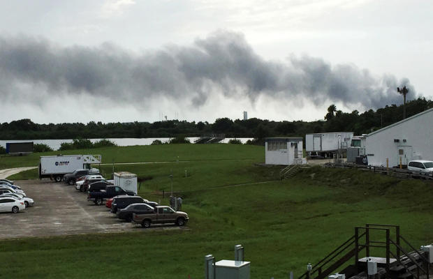 Smoke rises from a SpaceX launch site Sept. 1, 2016, at Cape Canaveral, Fla. NASA said SpaceX was conducting a test firing of its unmanned rocket when a blast occurred.