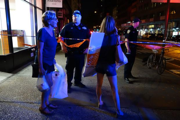 Two women look on as police block a road after an explosion in New York on Sept. 17, 2016. An explosion in New York's Chelsea neighborhood injured multiple people, police said.