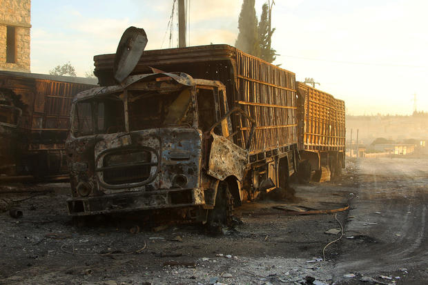 Damaged aid trucks are pictured after an airstrike on the rebel held Urm al-Kubra town, western Aleppo city, Syria