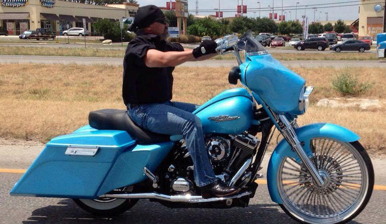 Bill Hall Jr. on his powder blue Harley