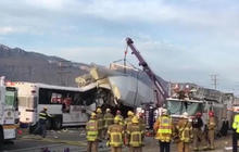 Police search for clues in California tour bus and big rig truck collision