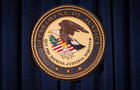 The Department of Justice logo is pictured on a wall after a news conference in New York Dec. 5, 2013.