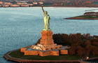 The sun lights the Statue of Liberty in New York Nov. 2, 2016.