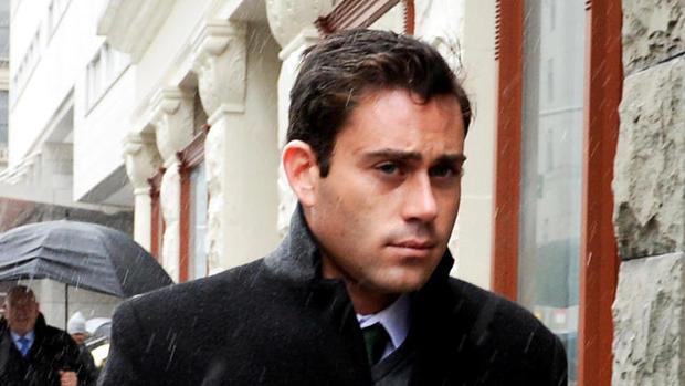 Jake Nolan walking to court in the rain