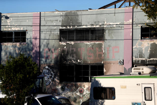 A charred wall is seen outside a warehouse after a fire broke out during an electronic dance party, resulting in at least nine deaths and many unaccounted for in the Fruitvale district of Oakland, California, Dec. 3, 2016.
