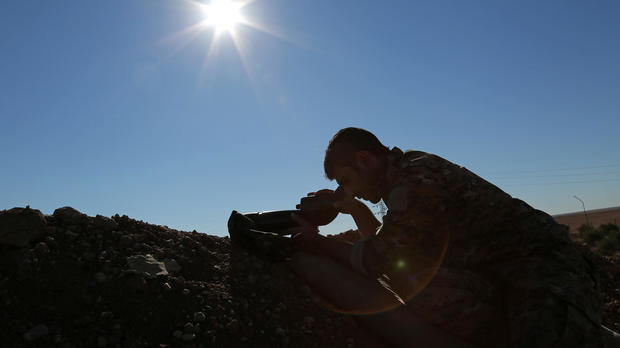 A Syria Democratic Forces fighter looks through a scope near the town of Tel al-Saman in the northern rural area of Raqqa, Syria, Nov. 17, 2016.