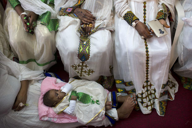 Eritrean Christian Orthodox migrant women attend a Mass at a makeshift church in Tel Aviv, Israel, April 23, 2016. Hundreds of faithful gather each week in the makeshift churches. With its walls bedecked with Christian paraphernalia, it is an unlikely scene in the heart of the Jewish state, hidden in nondescript buildings in hardscrabble south Tel Aviv.