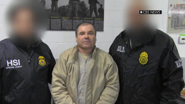 """Joaquin """"El Chapo"""" Guzman is led by agents from Homeland Security Investigations and the Drug Enforcement Administration after arriving on New York's Long Island on Jan. 19, 2017."""