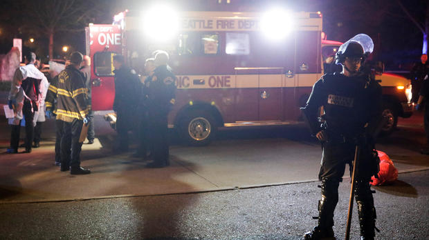 A Seattle Police officer is pictured near an ambulance where one person was shot at the University of Washington, where protesters arrived outside a speaking engagement by Breitbart News editor Milo Yiannopoulosin in Seattle, Washington, Jan. 20, 2017.