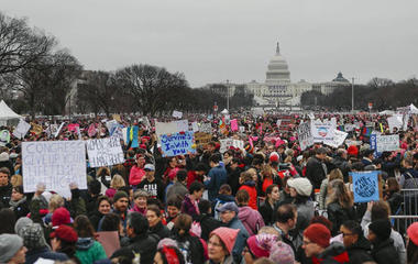 Women come together to protest President Trump