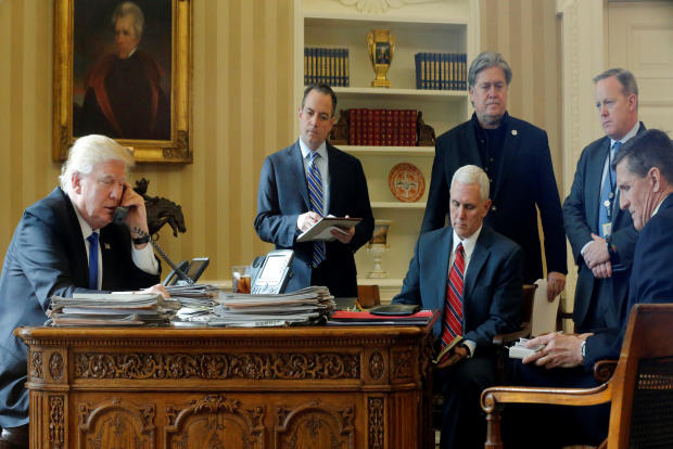 President Donald Trump, joined by, from left to right, chief of staff Reince Priebus, Vice President Mike Pence, senior adviser Steve Bannon, Communications Director Sean Spicer and National Security Adviser Michael Flynn, speaks by phone with Russia's President Vladimir Putin in the Oval Office at the White House in Washington Jan. 28, 2017.