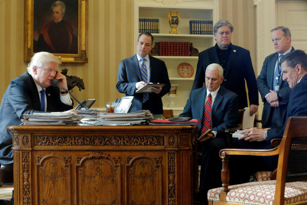 President Donald Trump, joined by, from left to right, chief of staff Reince Priebus, Vice President Mike Pence, senior adviser Steve Bannon, Communications Director Sean Spicer and National Security Adviser Michael Flynn, speaks by phone with Russia's Pr