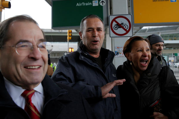 Iraqi immigrant Hameed Darweesh, center, walks out of Terminal 4 with U.S. Rep. Jerrold Nadler and U.S. Rep. Nydia Velazquez after being released at John F. Kennedy International Airport in Queens, New York, Jan. 28, 2017.