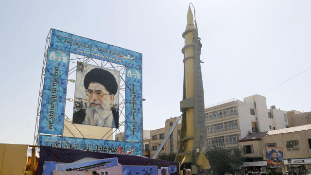 A Ghadr-F missile is displayed next to a portrait of Iran's Supreme Leader Ayatollah Ali Khamenei at a war exhibition to commemorate the 1980-88 Iran-Iraq war at Baharestan square, south of Tehran, on Sept. 26, 2016.