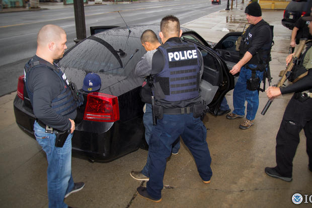 U.S. Immigration and Customs Enforcement (ICE) officers detain a suspect as they conduct a targeted enforcement operation in Los Angeles, California, on Feb. 7, 2017.