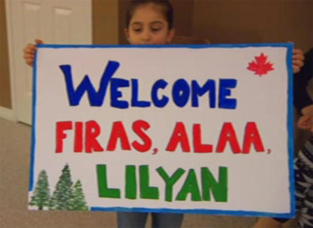 welcome-sign-syrian-refugees.jpg