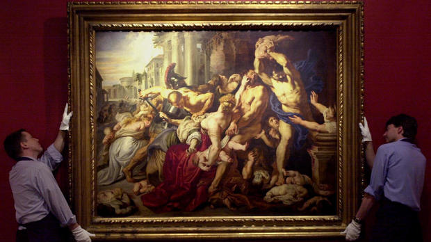 """Sotheby's staff display """"The Massacre of the Innocents"""" by Sir Peter Paul Rubens (1577-1640), painted between 1609 and 1611, at Sotheby's in London July 5, 2002."""